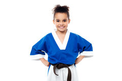 Smiling young karate kid. Confident looking young karate kid Royalty Free Stock Photos
