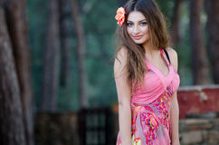 Smiling young lady with attached flower in hair Royalty Free Stock Photos