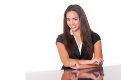 Smiling young lady at desk Royalty Free Stock Images