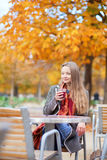 Smiling young lady drinking mulled wine Royalty Free Stock Photography