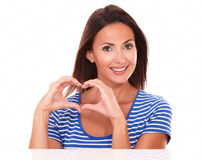 Smiling young lady with heart sign Royalty Free Stock Images