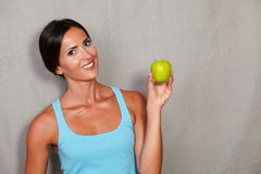 Smiling young lady holding an apple Stock Photo