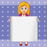 A smiling young lady holding an empty rectangular template Royalty Free Stock Image