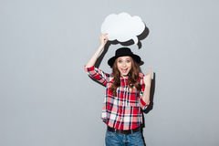 Smiling young lady holding speech bubble. Royalty Free Stock Images