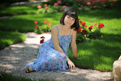 Smiling young lady in a park Stock Photo