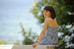 Smiling young lady in a park Stock Photos