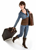 Smiling Young Lady Pulling her Luggage Royalty Free Stock Image