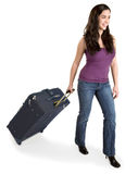Smiling Young Lady Pulling her Luggage Royalty Free Stock Photography