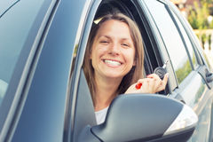 Smiling young lady sitting in a car Royalty Free Stock Images