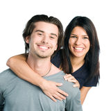 Smiling young latin couple piggyback