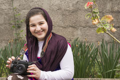 Smiling Young Little Girl Is Strapped an Analogue Camera on Her Royalty Free Stock Photography