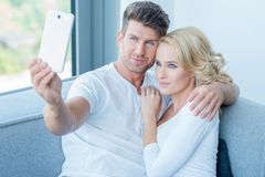 Smiling Young Lovers Taking Self Photos Royalty Free Stock Image