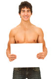 Smiling young ma. N with tanned muscular naked torso holding a blank form. Isolated on white Royalty Free Stock Photo