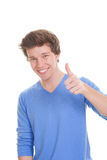 Smiling young mad thumbs up. For success Stock Photography