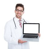 Smiling Young Male Doctor Displaying Laptop Royalty Free Stock Image