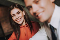 Smiling young male and female business coleagues. Concept of successful team work. Close up selective focus on cheerful business women with her young partner royalty free stock images
