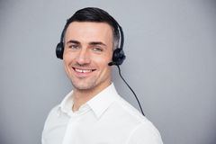 Smiling young male operator in headphones Royalty Free Stock Image