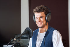 Smiling Young Male Singer In Recording Studio. Portrait of smiling young male singer in recording studio Royalty Free Stock Image