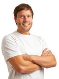 Smiling young man. Portrait of smiling young man in a white t-shirt isolated on white background Royalty Free Stock Photos