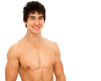 Smiling young man. With muscular and tanned naked torso. Isolated on white Stock Photos