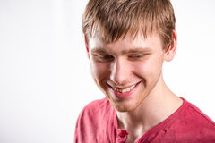 Smiling young man. Headshot of the smiling young man in red shirt Stock Images