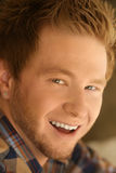 Smiling young man. With red hair looking at the lens Stock Photography