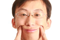 Smiling young man. One smiling young man isolated on white background Royalty Free Stock Photo