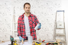 Smiling young man with aerosol paint Royalty Free Stock Photos