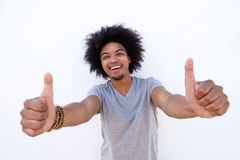 Smiling young man with afro showing thumbs up Stock Image
