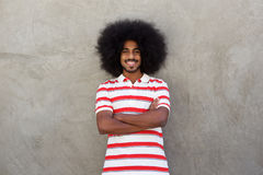 Smiling young man with afro and striped shirt. Portrait of smiling young man with afro and striped shirt Stock Photos