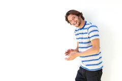 Smiling young man against white background Royalty Free Stock Image