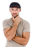 Smiling young man with arms crossed. Stock Photography