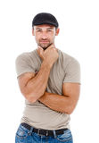 Smiling young man with arms crossed. Stock Images