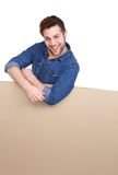 Smiling young man with blank poster Stock Images