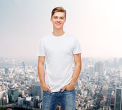 Smiling young man in blank white t-shirt Royalty Free Stock Photography
