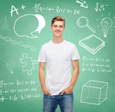 Smiling young man in blank white t-shirt Stock Images