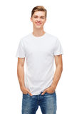 Smiling young man in blank white t-shirt royalty free stock photos