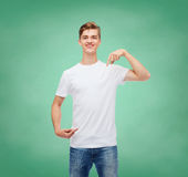 Smiling young man in blank white t-shirt Stock Photo