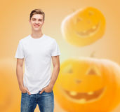 Smiling young man in blank white t-shirt Stock Photography