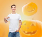 Smiling young man in blank white t-shirt Stock Image