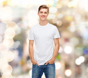 Smiling young man in blank white t-shirt Royalty Free Stock Image
