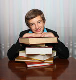 Smiling young man with books Royalty Free Stock Photos