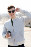 Smiling young man or boy drinking coffee Royalty Free Stock Photos