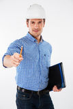 Smiling young man builder in building helmet pointing on you Stock Images