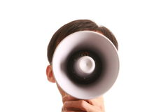 Smiling young man and bullhorn. Bullhorn and One smiling young man isolated on white background Stock Photography