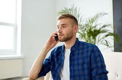 Free Smiling Young Man Calling On Smartphone At Office Stock Photo - 110941500