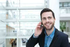 Smiling young man calling by phone. Close up portrait of a smiling young man calling by mobile phone Stock Photography