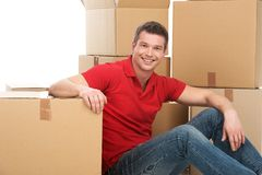 Smiling young man with cardboard box. Stock Photography