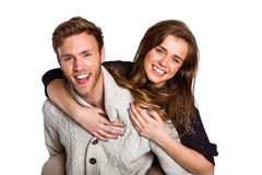 Smiling young man carrying woman Stock Photography