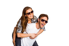 Smiling young man carrying woman Stock Image